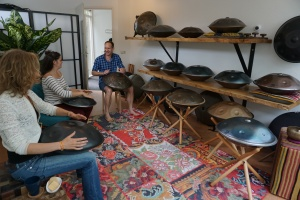 Playing HandPan drum on workshop